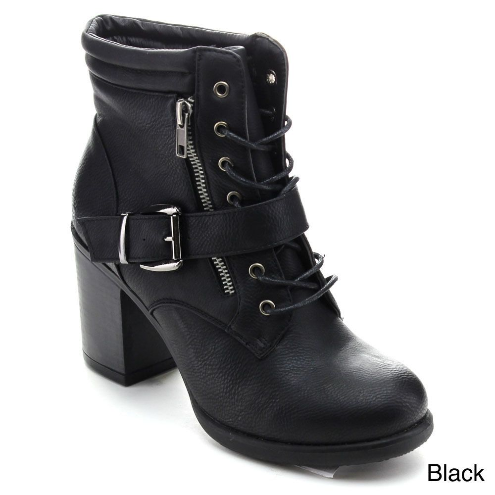 Get ready to go for a ride with these stylish ankle booties. They feature a round toe, faux leather upper, lace up with metal eyelets, and decorative buckle with silvertone hardware. Finished with cushioned insole and smooth lining.
