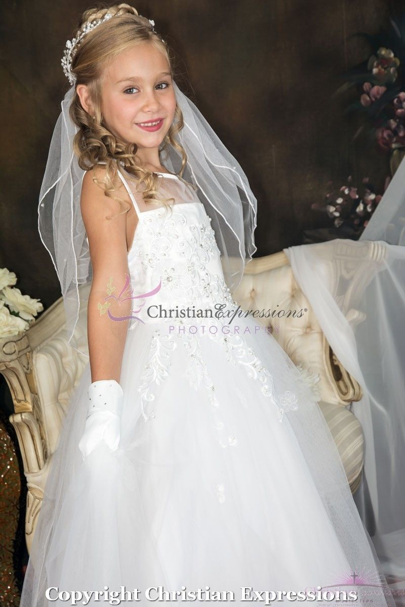 662d3b957e5 Sleeveless tea length first communion dress features a fully lined tulle  skirt with sequin appliques