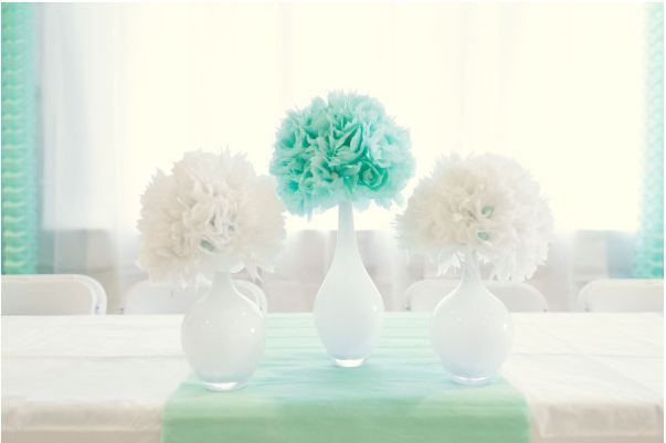 Classy way to do pom pons!  In mercury glass or gold as opposed to white vases though