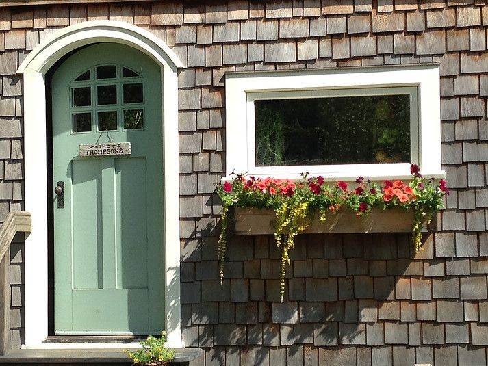 Adorable tiny house entrance with arched door!