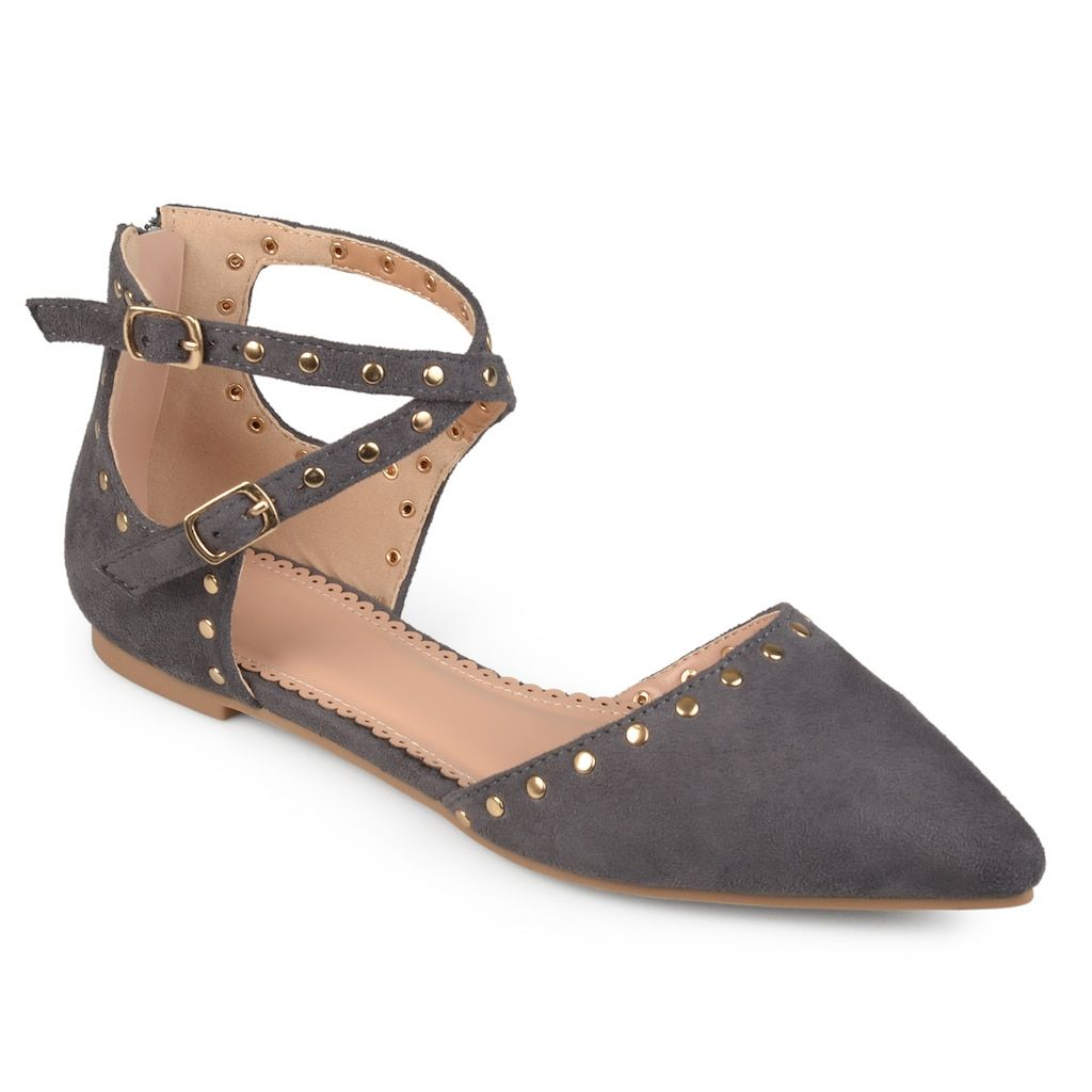659ee4ef805 Step into chic style with the ankle strap flat by Journee Collection. These  flat shoes are made with faux suede uppers and highlight pointed toes and  closed ...