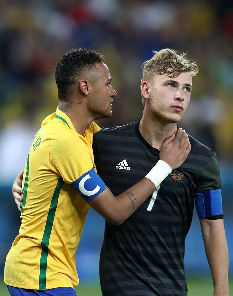 Neymar of Brazil commiserates with Maximilian Meyer of Germany following the…
