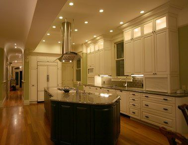 Love the illuminated upper cabinets finished off with molding. White ...