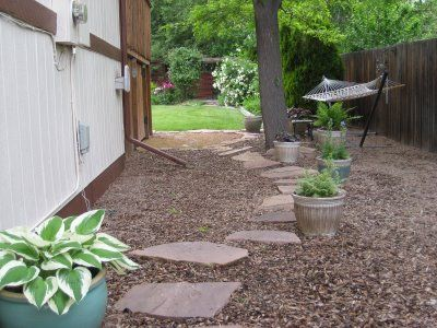 Side Yard   Flag Stones With Wood Chips