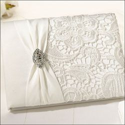 Cream wedding guestbook finished with lace and rhinestone buckle. £23.99
