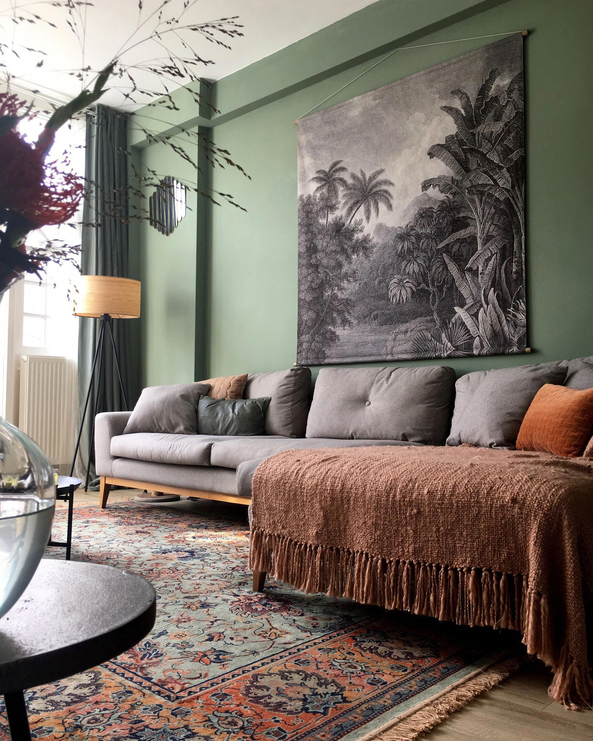 18 Gorgeous Grey Living Room Ideas: Gray Tapestry Over A Gray Sofa, Green Walls & A Beautiful