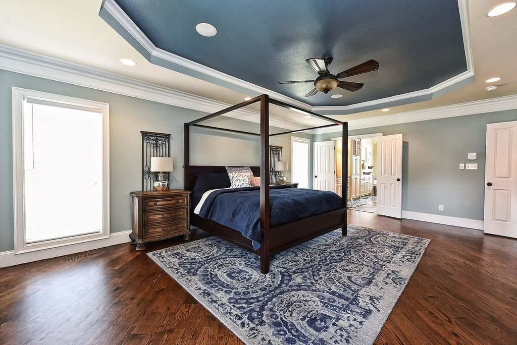 Traditional Master Bedroom with Crown molding, High