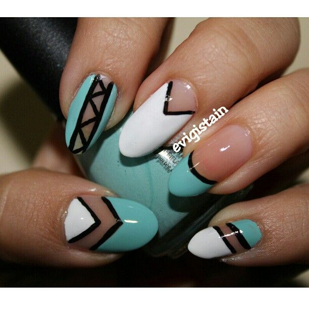 turquoise and white negative space nail art design using