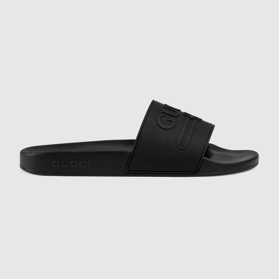 e41d7cec440 Shop the Gucci logo rubber slide sandal by Gucci. The feel of summer  permeates the Pre-Fall 2018 collection. The Gucci vintage logo - originally  inspired by ...