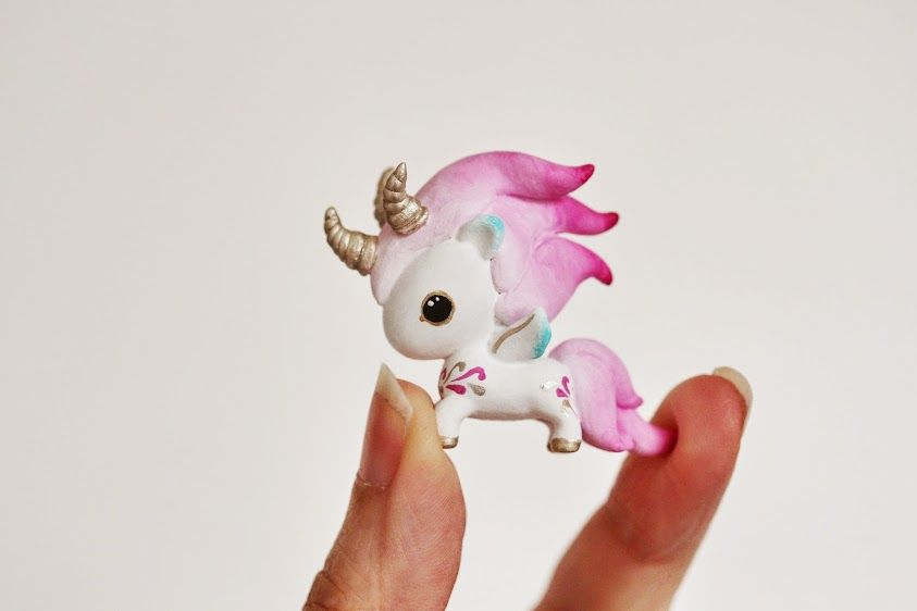 A+Micro+Tokidoki+Unicorn+(approx+1+inch+tall)+got+customized+in+pink,+turquoise+and+gold!    Big+eyes,+long+fluent+mane,+three+dragon+horns+and+the+cutest+handpainted+tattoos..+a+One+Of+A+Kind+Art+Toy++that+awaits+to+join+your+collection!+:+)    Ps:+more+pics+of+my+customs+can+be+found+on+my+blog...