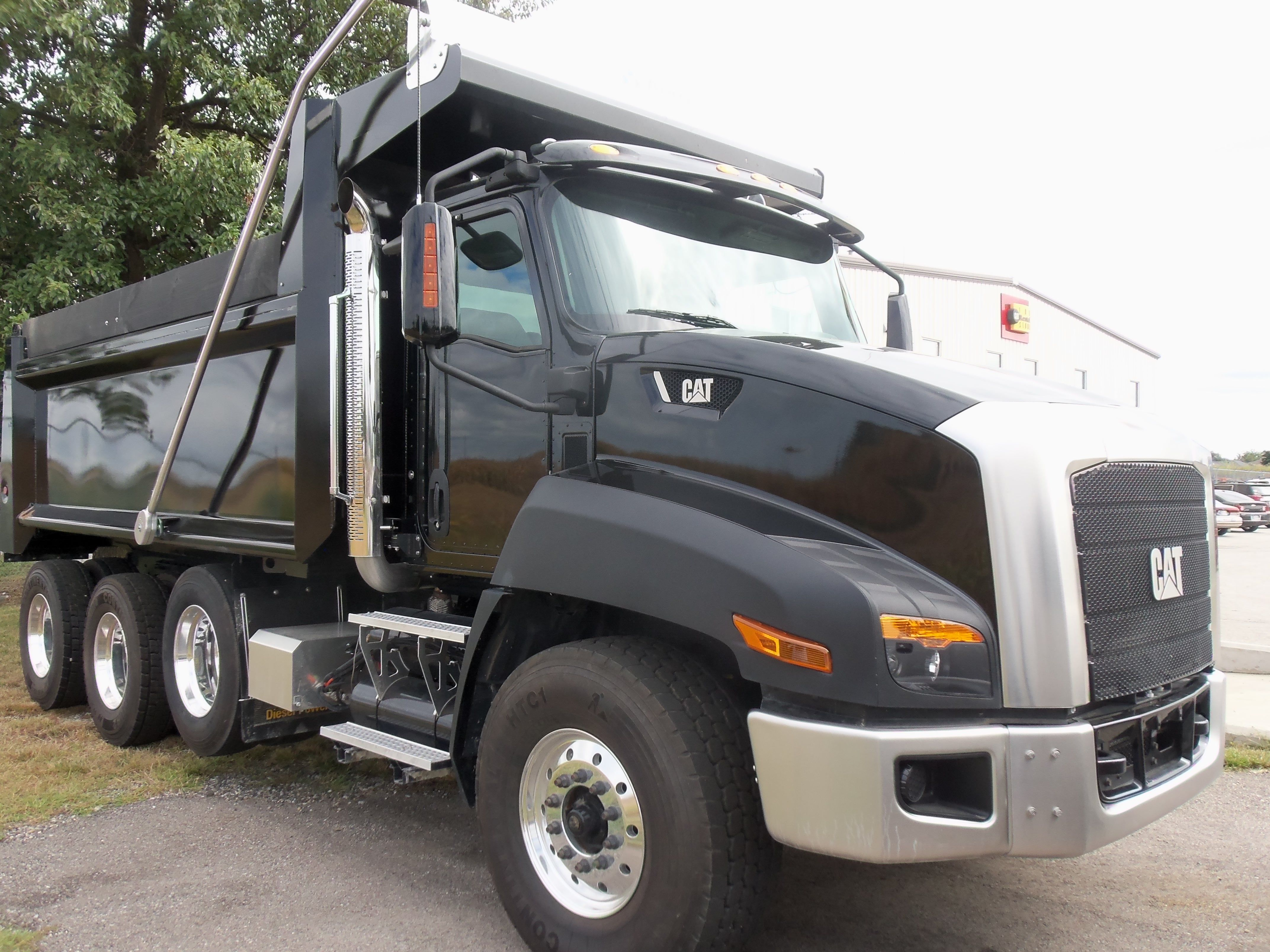 Caterpillar ct660 3 axle black dump truck