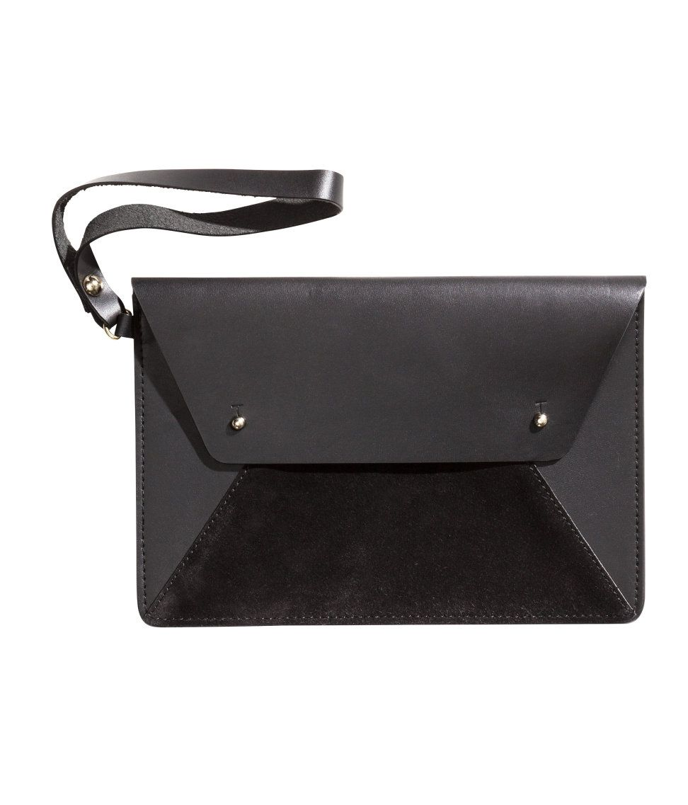 Small black leather clutch bag with decorative suede panel ...