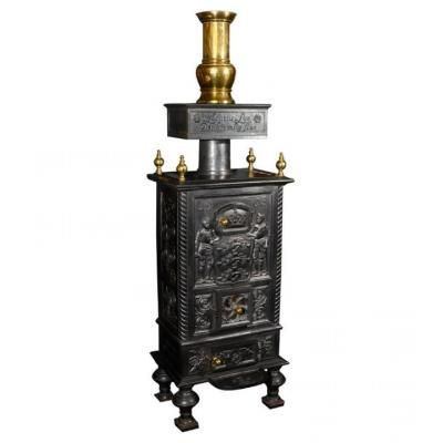 Marvin Alexander,Inc. Danish cast iron decorated heating stove with brass finials and stack, circa 1903