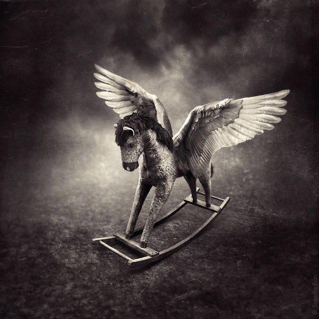 Rocking horse with wings. Digital art.