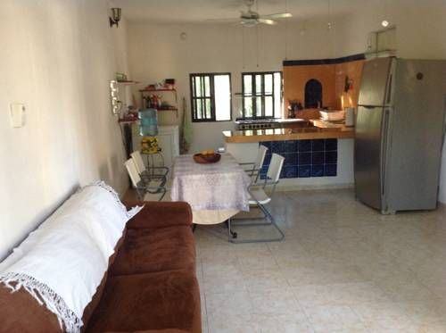 Casa Aurora Puerto Morelos Casa Aurora is a property located in Puerto Morelos, 30 minutes? drive from both Cancun and Playa del Carmen.  Free bicycles on loan can be found on site.  The house has free WiFi access.