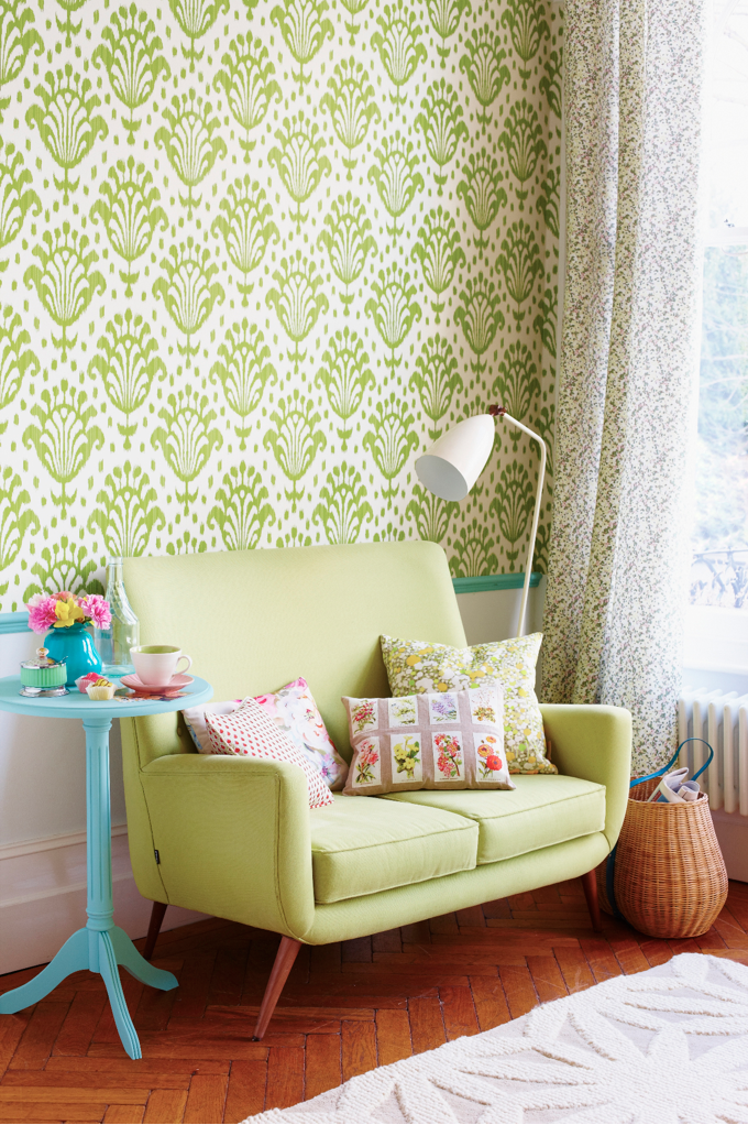 Whimsical color. Like the colors. The wallpaper & the teal table ...