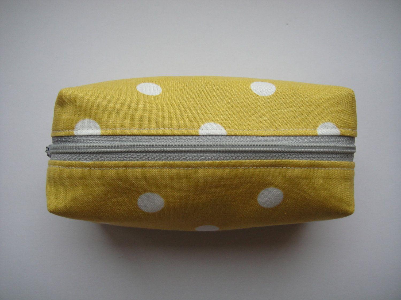 Mustard yellow with white polka dots boxy makeup bag. 12