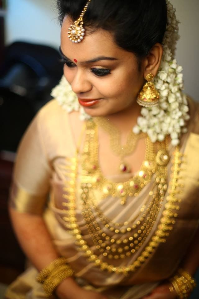 Real Kerala Bride Shruthy In Gold Saree With Gold Jewelry