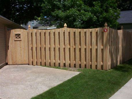 Concave Shadow Box Fence Installation In The Menomonee