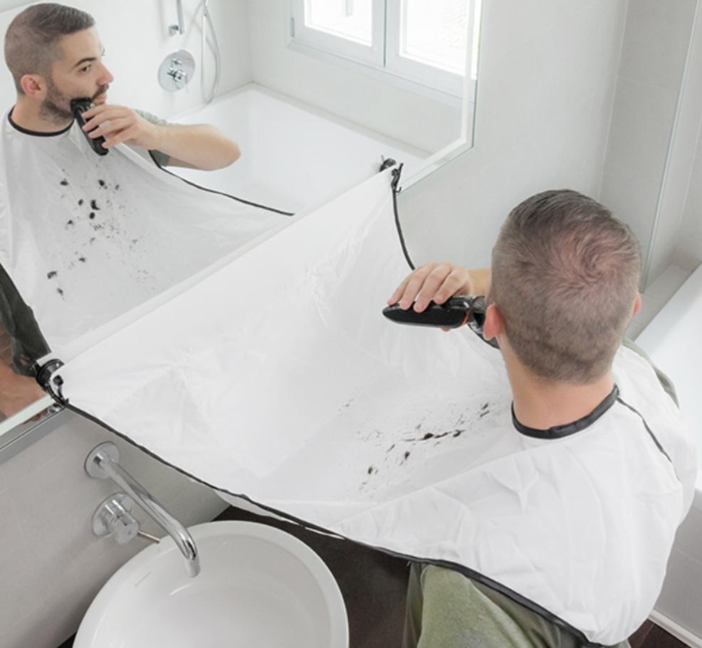 a man sitting at a sink
