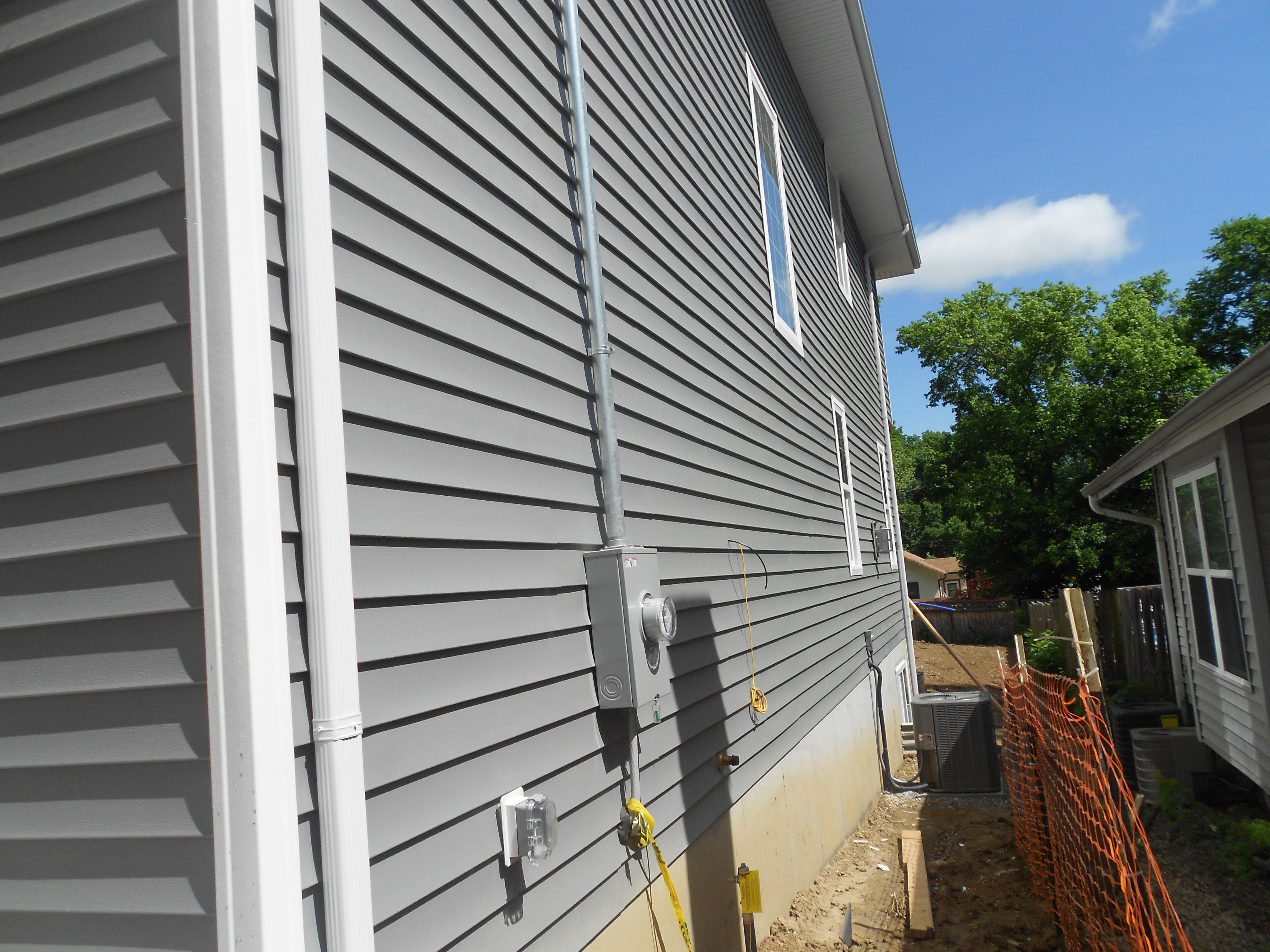 Side Of House Showing Off The Mastic White Vinyl Corner