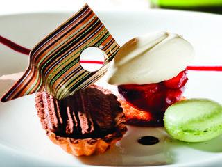 Dark chocolate tart with Muscadel and prune ice cream and roasted plum