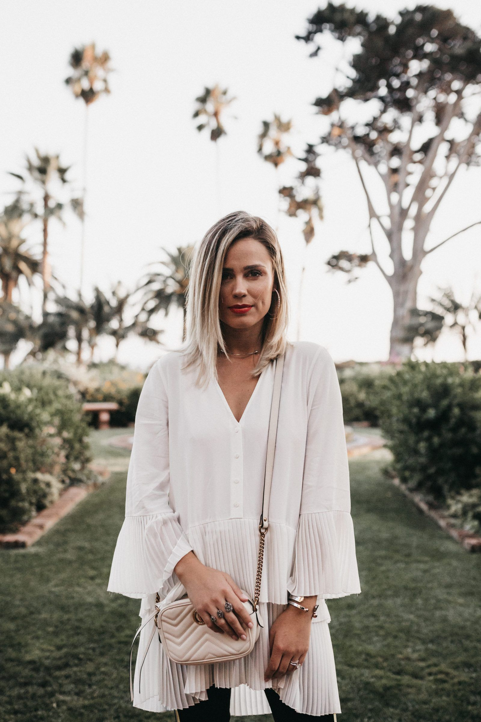 e20fa9b64d5 Houston fashion blogger Uptown with Elly Brown wears a white pleated Zara  blouse