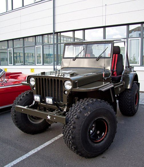 Big Wheels Done Right .....Jeep Style! Love Those Red Seat