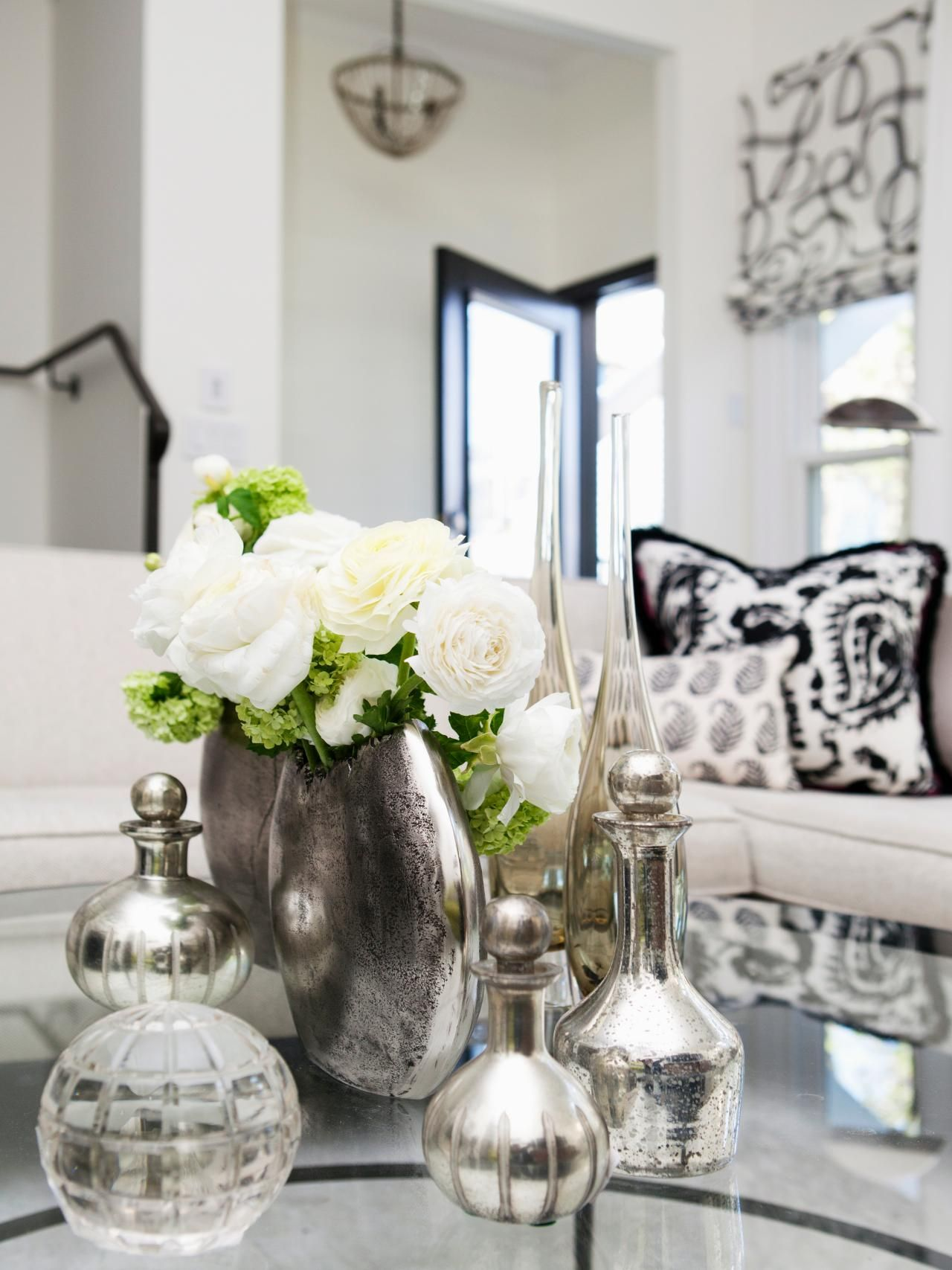 A gorgeous white living room is accented by a lovely grouping of ...