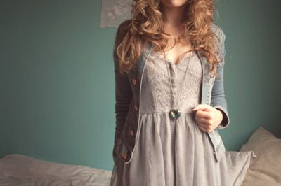 love the sweater over the dress