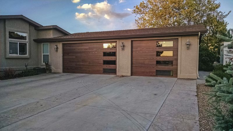 Gorgeous Dark Oak Plank Woodtones Doors These Beautiful Doors Are Highly Insulated Model 3216p With Sta Garage Doors Steel Garage Doors Garage Door Makeover