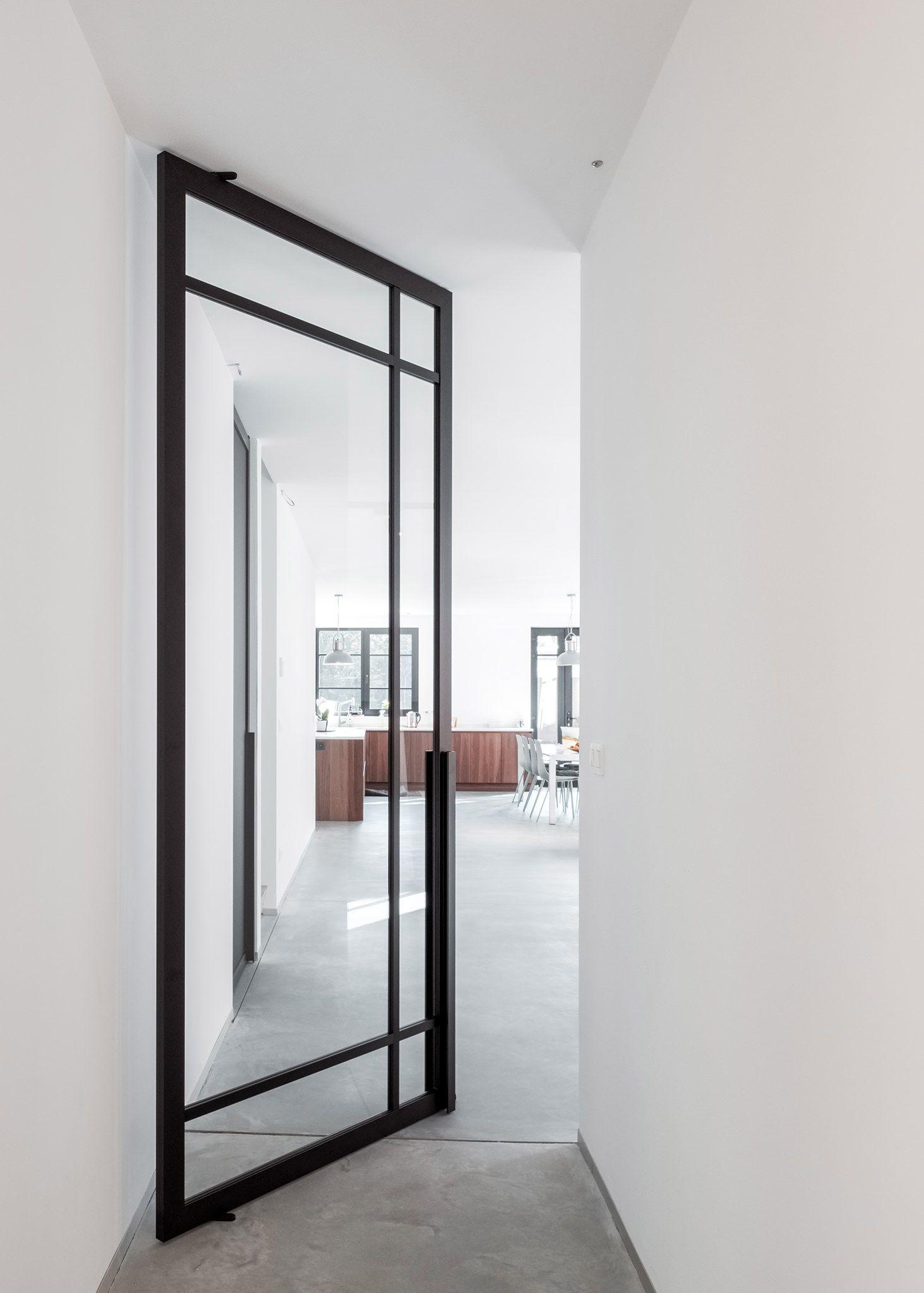 2020的Modern take on crittall style doors with a pivot door