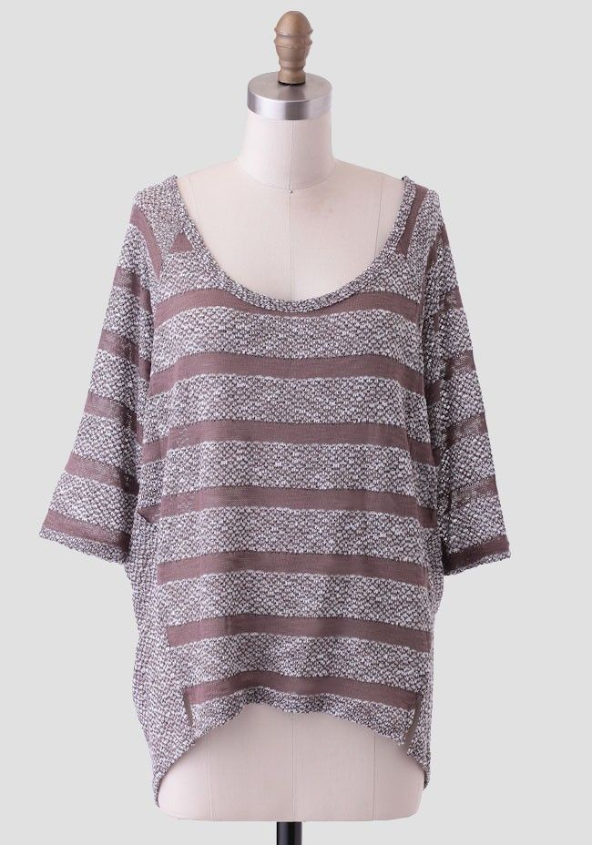 This cozy open knit sweater in marled gray and mocha-brown hues features a striped front with a solid marled back. Designed with fitted dolman sleeves, this soft high-low sweater is perfect for p...