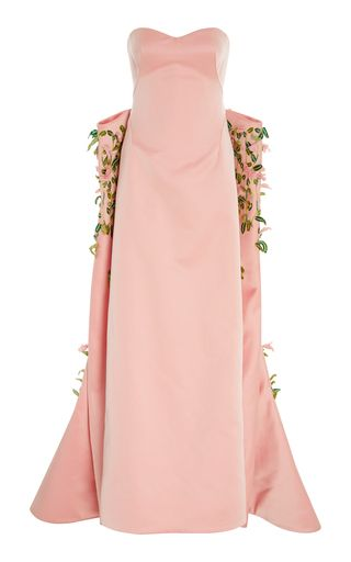 This **Zac Posen** gown features a sweetheart neckline, structured embellished train, and satin finish.