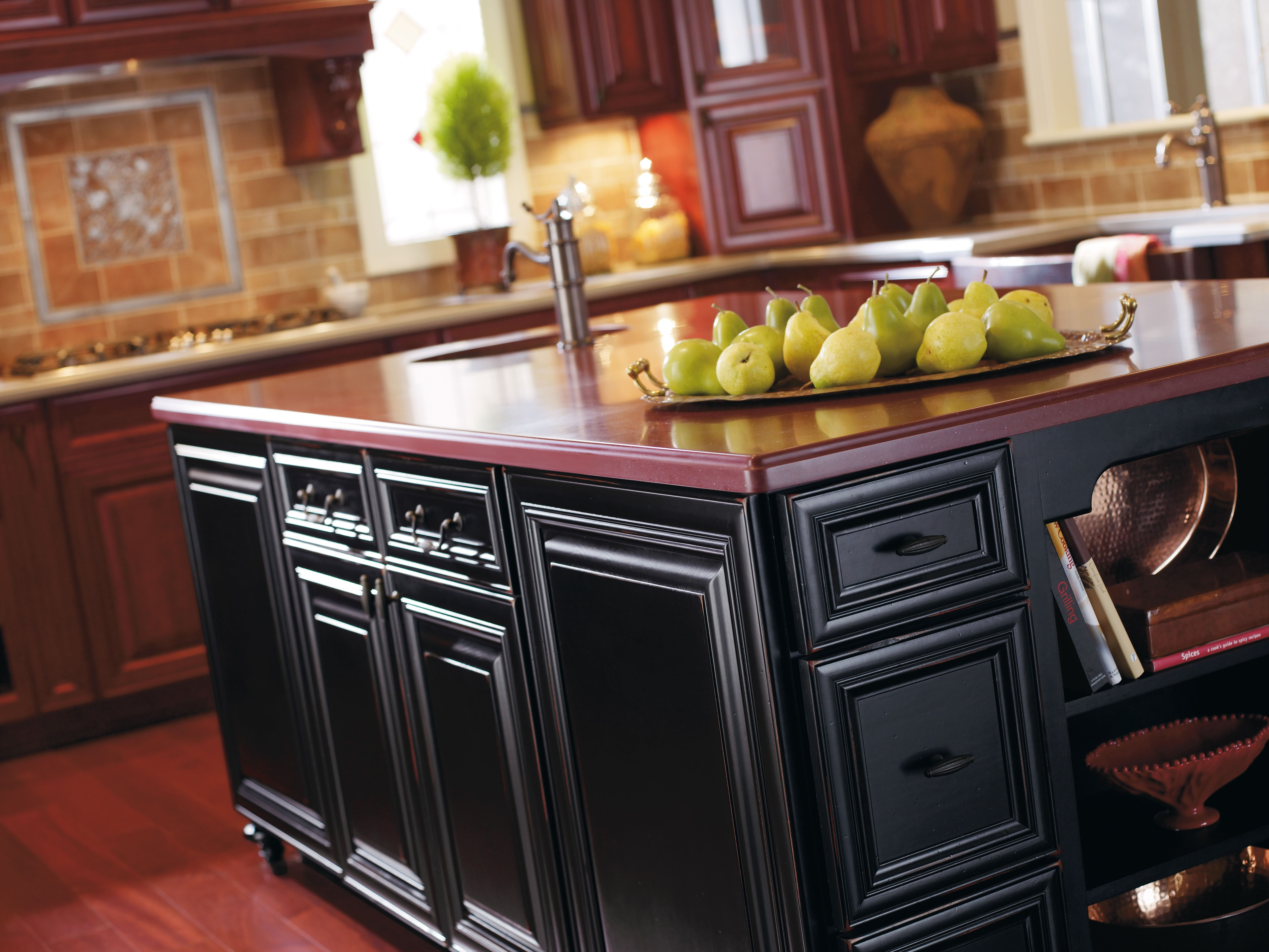 This Traditional Style Kitchen Featuring Cherry Wood Omega Cabinets With A Bur Farmhouse Style Kitchen Cabinets Kitchen Cabinet Styles Kitchen Design Showrooms