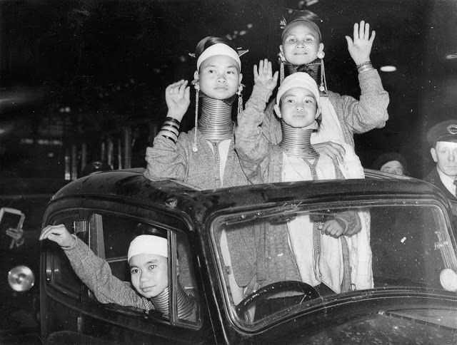 Padaung women wave at Londoners upon their arrival at Victoria Station. Burmese Beauties Visited London in 1935