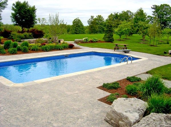 Swimming pool area design inspiring good swimming pool for Landscaping ideas for pool areas