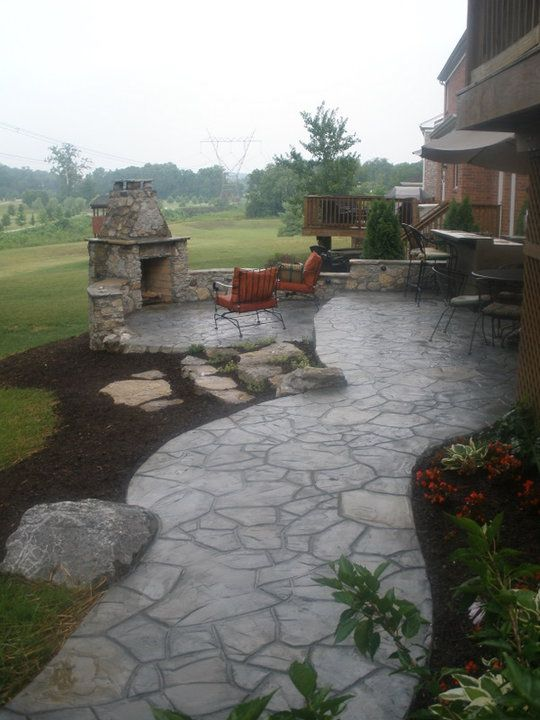 Carved Concrete Patio And Outside Fireplace With Seating Wall