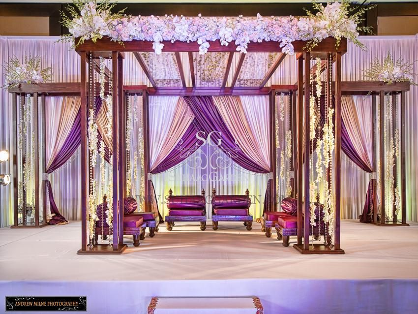 Hilton downtown tampa florida indian wedding garden blossom mandap garden theme wedding mandap purple drapery for indian wedding junglespirit Image collections