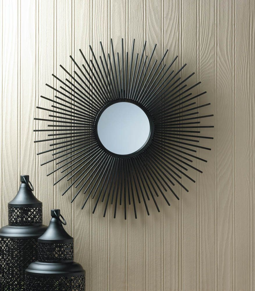1feebcd1e307 This sun-inspired mirror will make your rooms decor sizzle with style.  Black iron rays make a gorgeous pattern around the circular mirror.