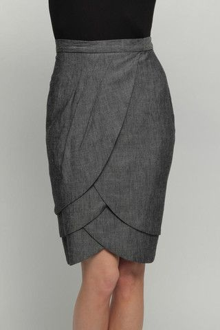 PETAL SKIRT- GREY ANATOMY  $183.00  Fitted pleated skirt with layer in a cute dark denim. Pencilshape. Sits above waist. Fully lined. Dry clean.