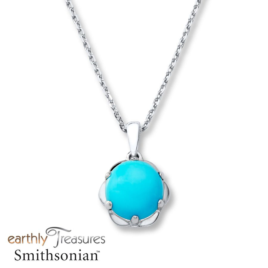A round turquoise accented on either side by bezelset round