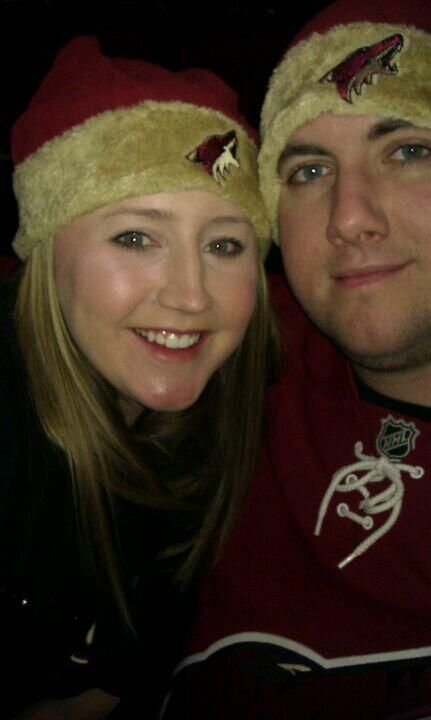 A cute couple of Coyotes fans share a pic showing their Yotes pride and Howliday cheer.