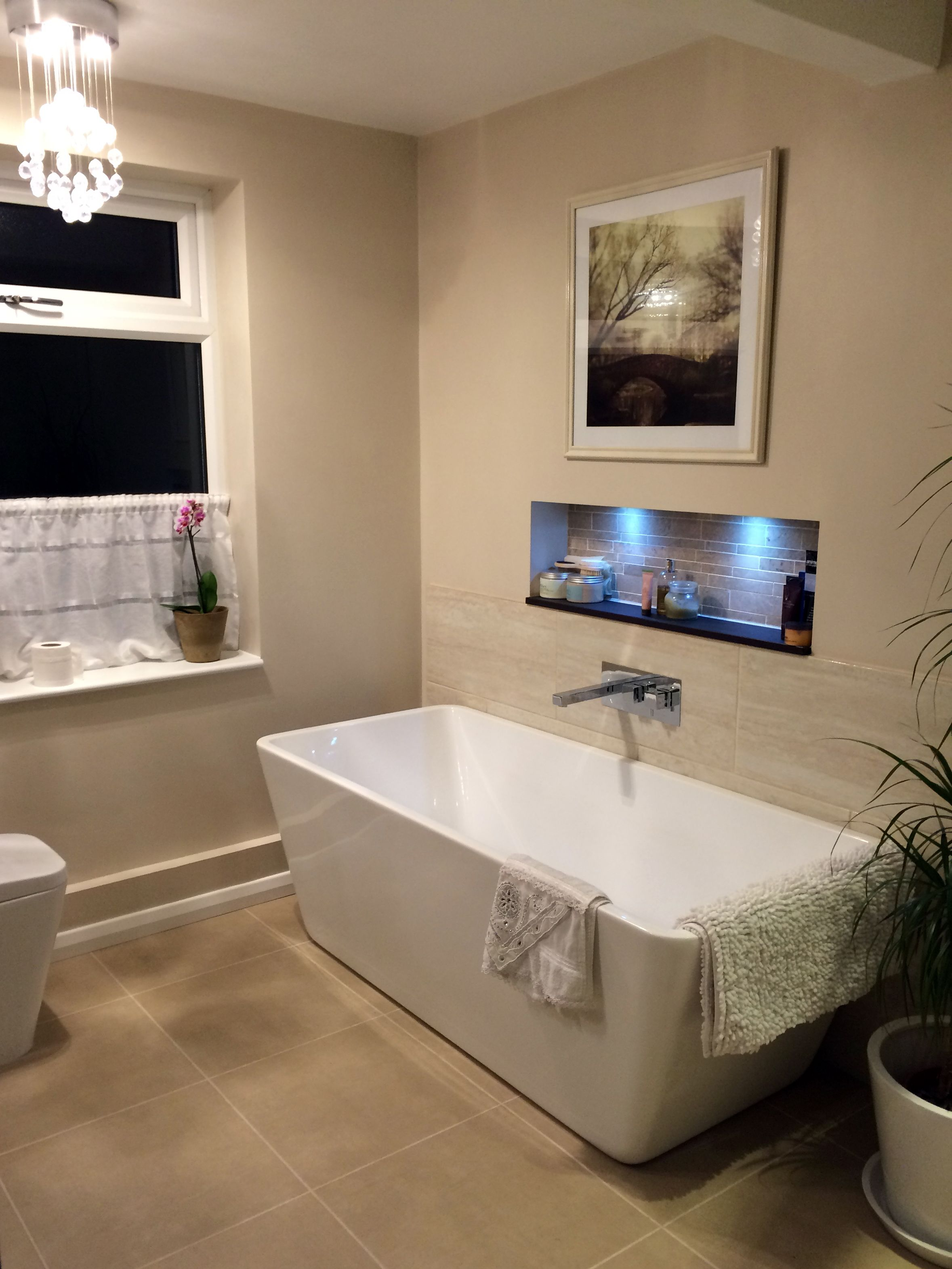Freestanding bath, waterfall tap, recessed shelf alcove with LED ...