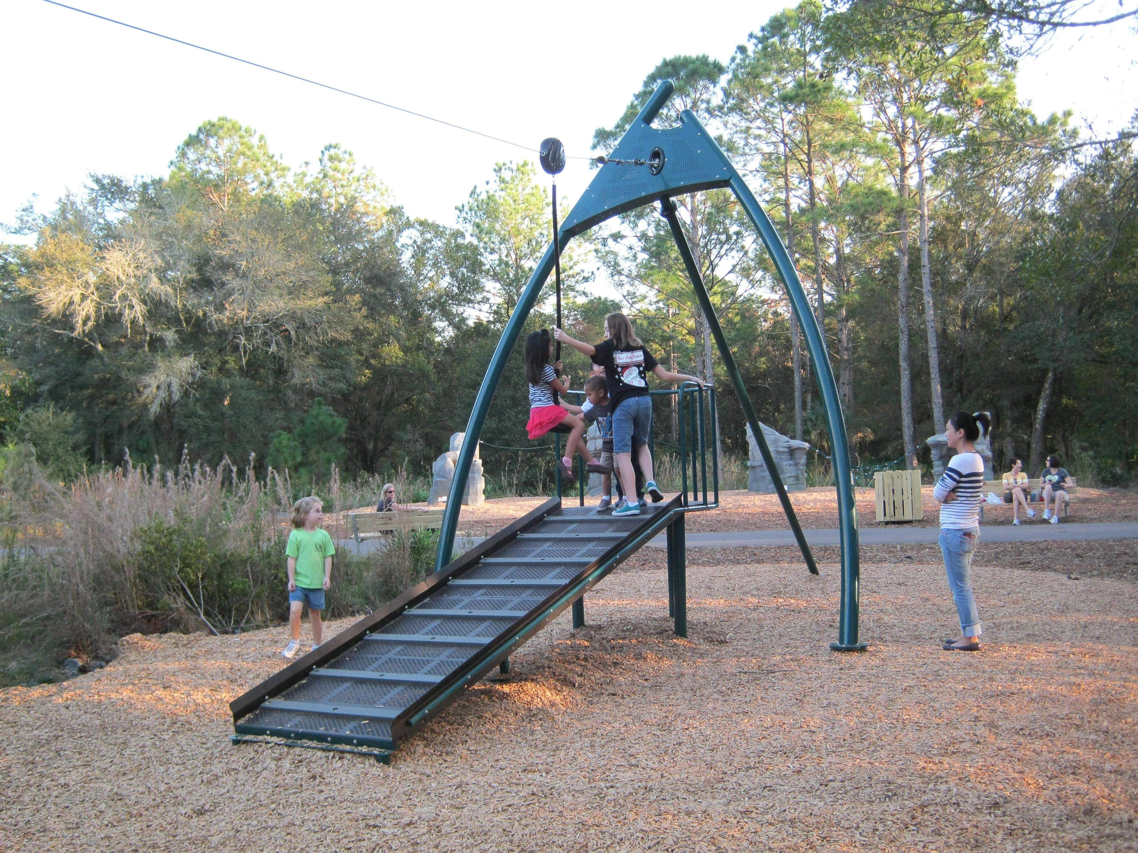 the zip line at new tampa nature park is a featured attraction for