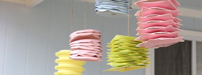 Paper plate hanging lanterns these casual and cute hanging paper plate hanging lanterns these casual and cute hanging decorations were made from simple paper plates theyre super easy and inexpensive to make solutioingenieria Choice Image