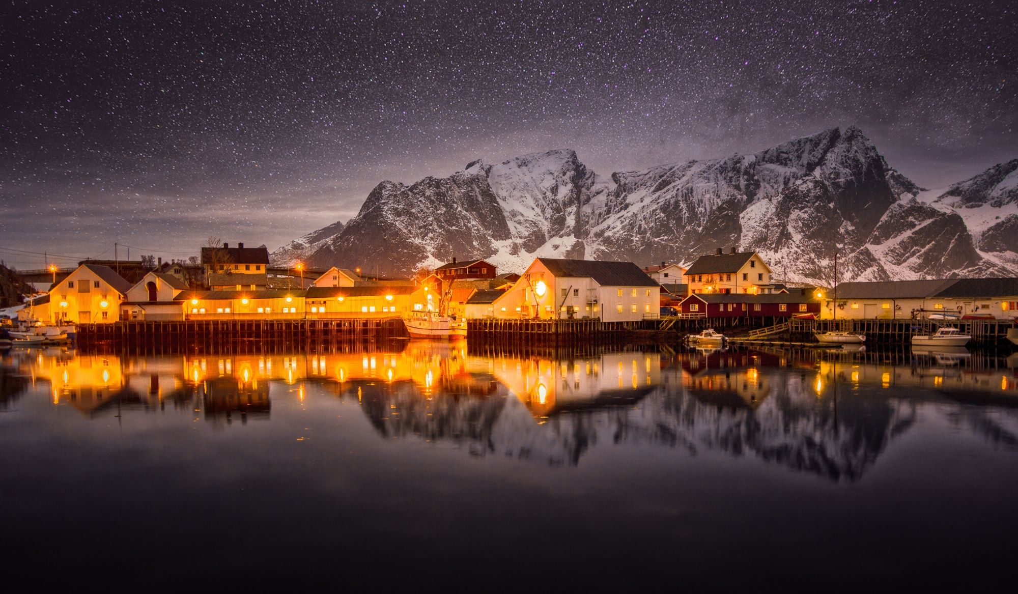 If ever an image screamed of tranquility, this is it! The calmness of the water in the foreground and the blanket of stars in the background frame this fishing village nicely. You can almost feel the cold, crisp air!