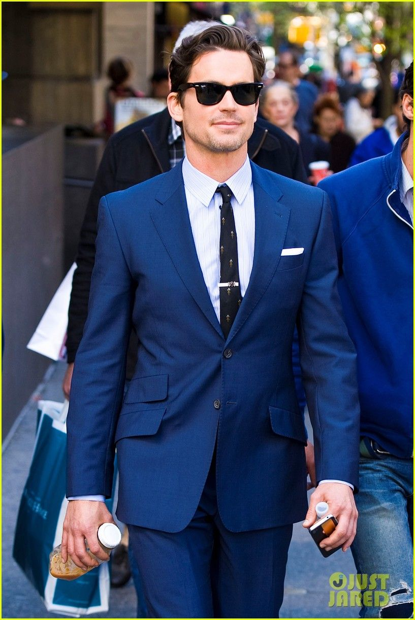 Matt Bomer looks dapper in a blue suit with Ray Ban sunglasses on ...