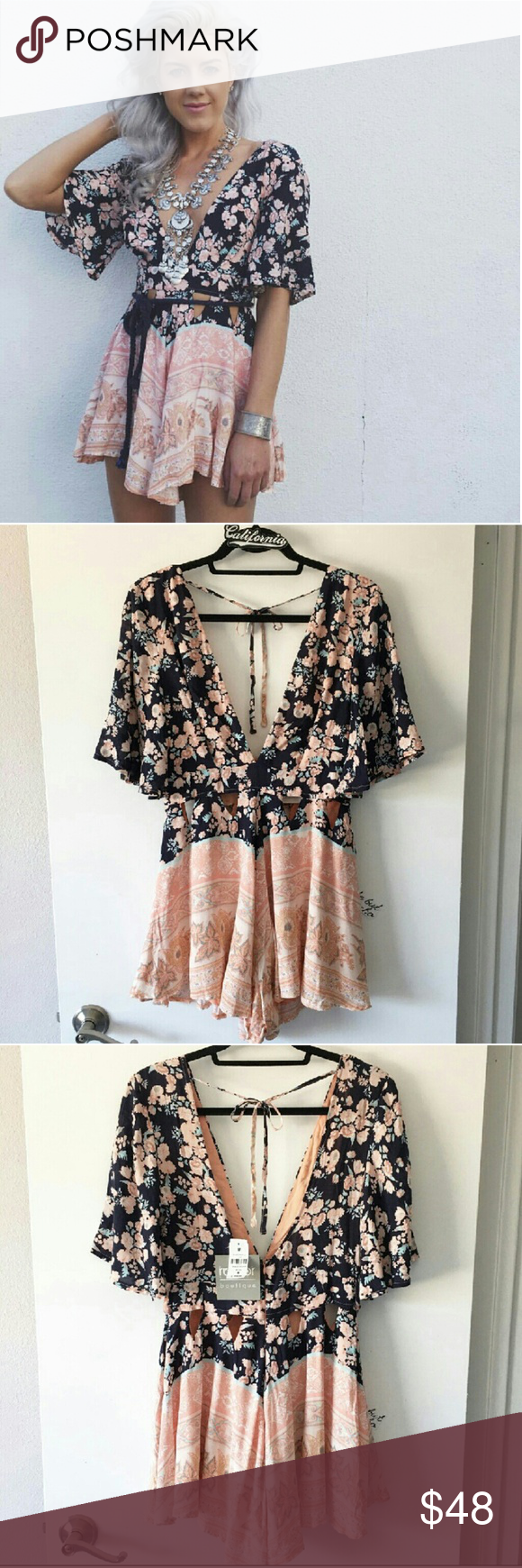 c7eafafd244a NEW LF Rumor Boutique floral romper Adorable floral navy and peach romper  by Rumor Boutique sold at LF Stores. This romper has a cute floral print