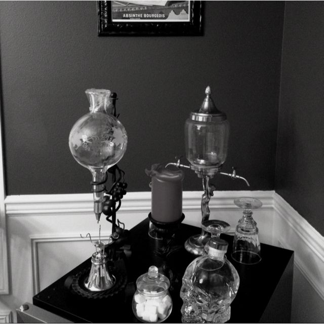 Decanter, fountain, balancier, and a vodka filled glass skull.